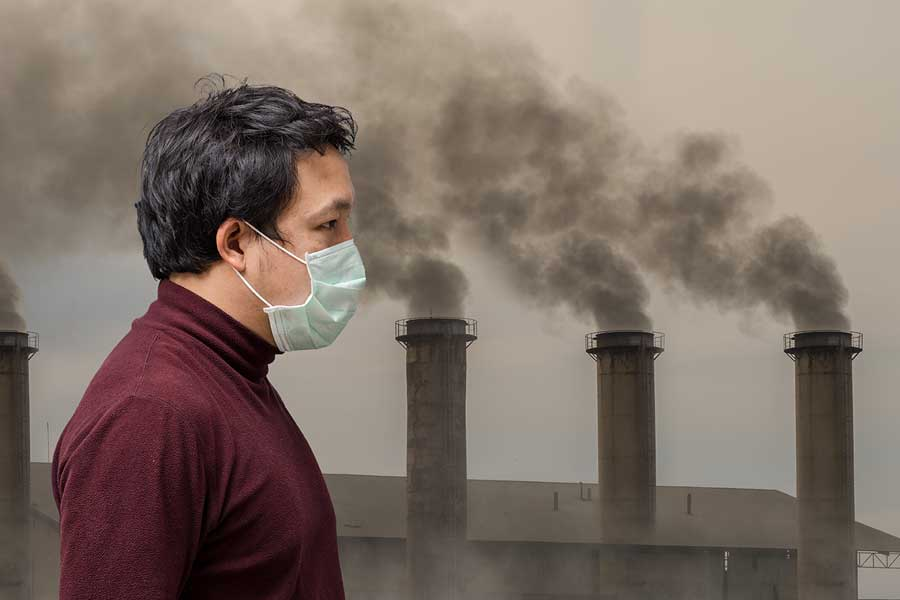 Man wearing mask in air pollution
