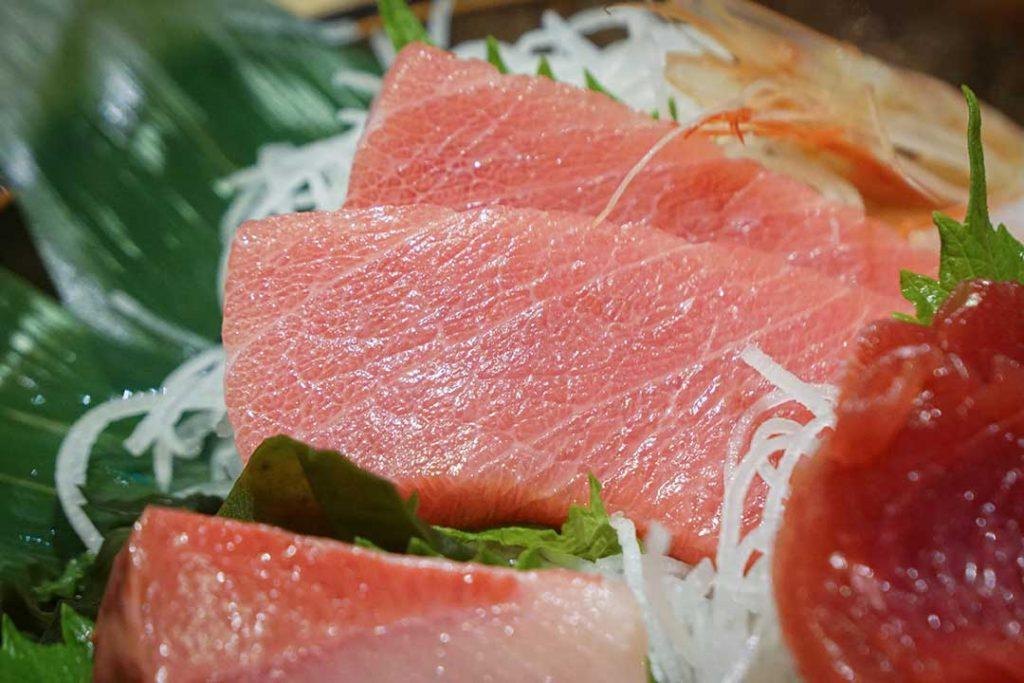 Sliced otoro sashimi in a mixed sashimi set