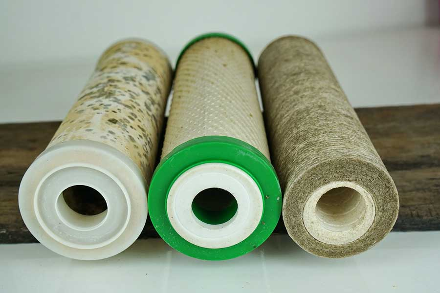 Dirty used cartridge filter of water purifier, filtration