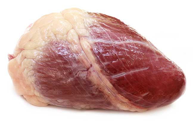 Beef heart over white background